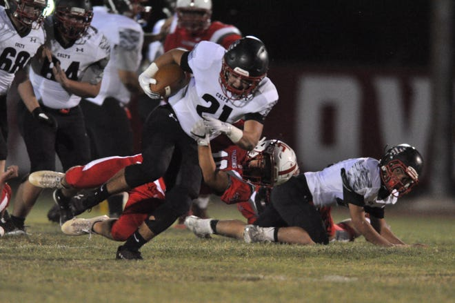 NMMI Colt Gus Curmutt works for an extra yard against the Loving Falcons Sept. 28.