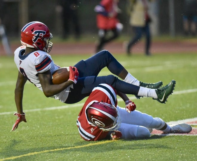 Franklin's Fredrick Biles (8) eludes the Glenn tackler and scores a touchdown.