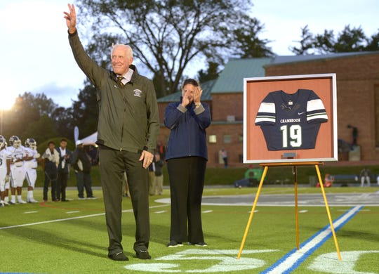 Pete Dawkins waves to the crowd as his No. 19 jersey is retired before the start of the 2018 homecoming game played Sept. 28, 2018.