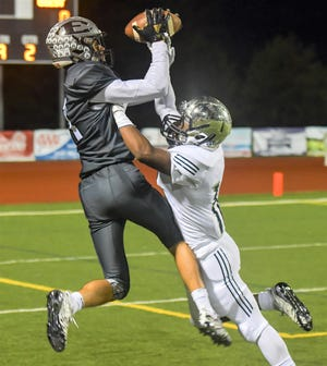 South Lyon East's Sean Clary makes the grab in Friday's Lakes Valley Conference win over Waterford Mott.