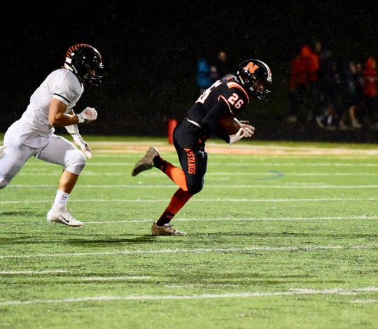 One of Northville's best players Friday night was senior running back Enzo Rodriguez (26), scooting away from a Brighton defender on this play.
