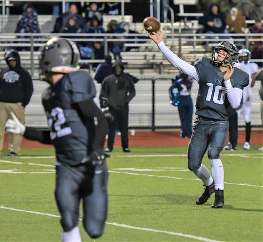 South Lyon East quarterback Chris Kaminski (10) makes the throw as teammate Matt Gilbert gets loose in the flat.