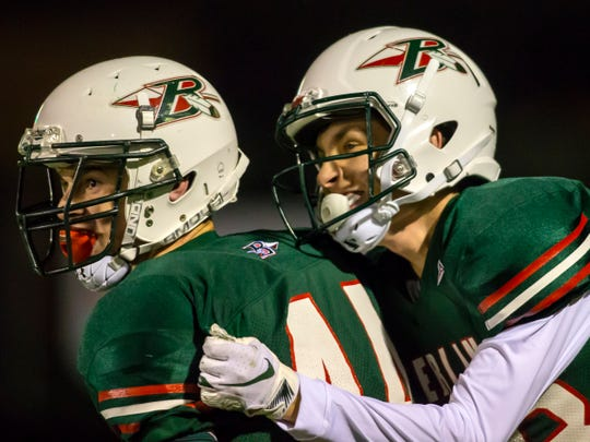 Berlin's Tyler Kwidzinski and Ryan Breeden celebrate in the end zone as the Indians gained a two-touchdown lead against Kewaskum on Friday.