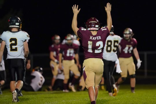 Omro quarterback Jacob Kafer (12) celebrates a scoring play in the third quarter against Montello/Princeton/Green Lake on Friday night at Fruth Field.