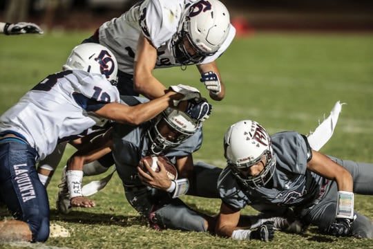 Rancho Mirage's Jevin Dorsey goes down with the ball against La Quinta on Friday, September 28, 2018 in Rancho Mirage.