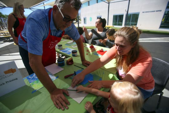 Ashley Hicks, of Palm Desert, and her daughter Tallulah Hicks, 3, make block prints with the help of Ben Shearer, of Cathedral City, during the Nickelodeon's Worldwide Day of Play at the Children's Discovery Museum of the Desert on Saturday, September 28, 2018 in Palm Desert. The block print was organized by the Palm Springs Art Museum.