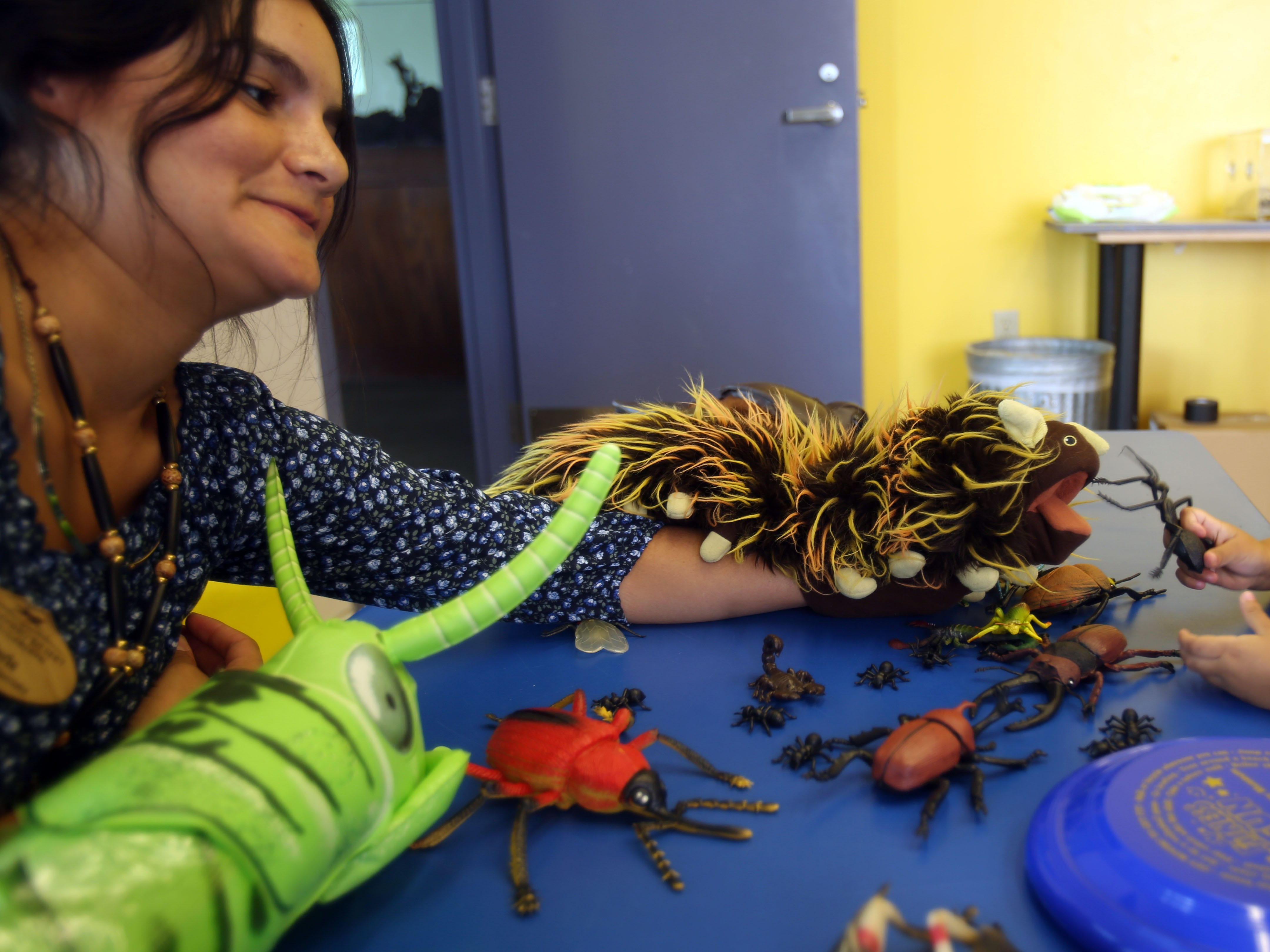 Emily Estes, 3, with plastic bugs at the Living Desert booth during the Nickelodeon's Worldwide Day of Play at the Children's Discovery Museum of the Desert on Saturday, September 28, 2018 in Palm Desert.