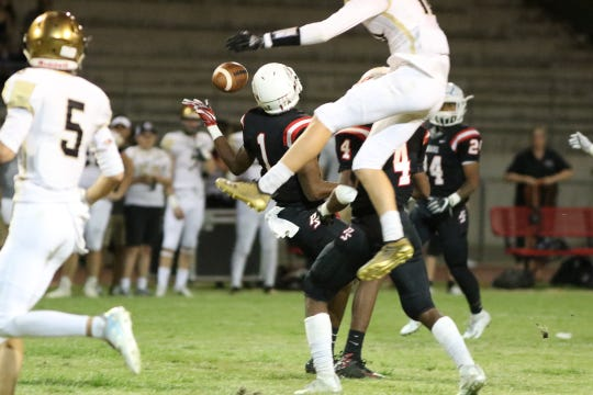 Xavier Prep junior Kai Killebrew (No. 5) looks on during an incomplete pass Sept. 28 against Palm Springs. Hours after this game, Killebrew and two other Xavier Prep student athletes were involved in a car accident.
