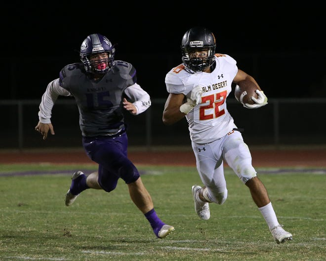 Palm Desert running back Jordan Garcia races around the end for a gain during the first half against Shadow Hills on Friday, Sept. 28, 2018.