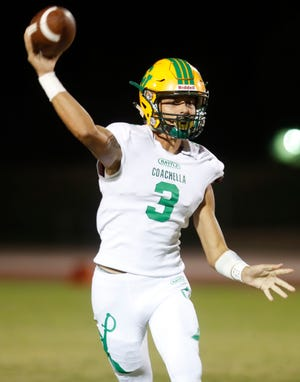 Coachella Valley High School's Donny Fitzgerald throws for a pass against Cathedral City High School.