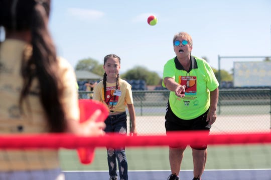 Raise Casals instructs Esmeralda Quintero, 9, on the basics of tennis at the Indian Wells Tennis Garden on Saturday, September 29, 2018 in Indian Wells during the Rosie Casals & Pancho Gonzalez Kids Tennis Fiesta. Roughly 120 third and fourth graders from the Valley participated in the event.