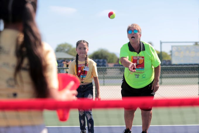 Raise Casals, former professional tennis player and International Tennis Hall of Fame inductee instructs Esmeralda Quintero, 9, on the basics of tennis at the Indian Wells Tennis Garden on Saturday, September 29, 2018 in Indian Wells during the Rosie Casals & Pancho Gonzalez Kids Tennis Fiesta. 120 third and fourth graders from the Coachella Valley Unified School District Expanded Program attend the camp. The equipment was donated to them two years before by tennis legend Billie Jean King.