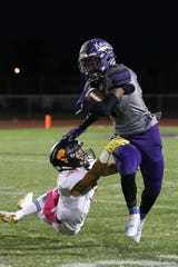 Shadow Hills' Kevin Johnson tries to shake off a Palm Desert tackler during the first half Friday, Sept. 28, 2018.