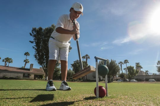 Blake Fields an 11-year-old Croquet prodigy hits a trick shot at his home turf at Mission Hills Country Club in Rancho Mirage on Thursday, September 27, 2018.