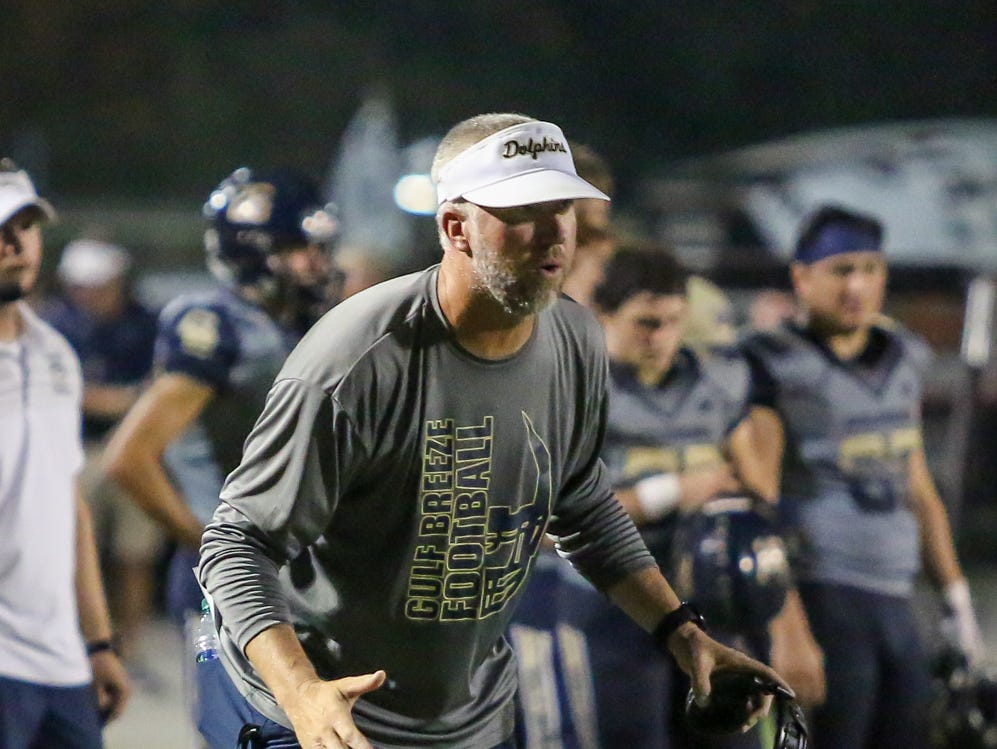 Gulf Breeze head coach Bobby Clayton watches as his defenders make a goal line stance against Milton in the District 2-6A game at Gulf Breeze High School on Friday.