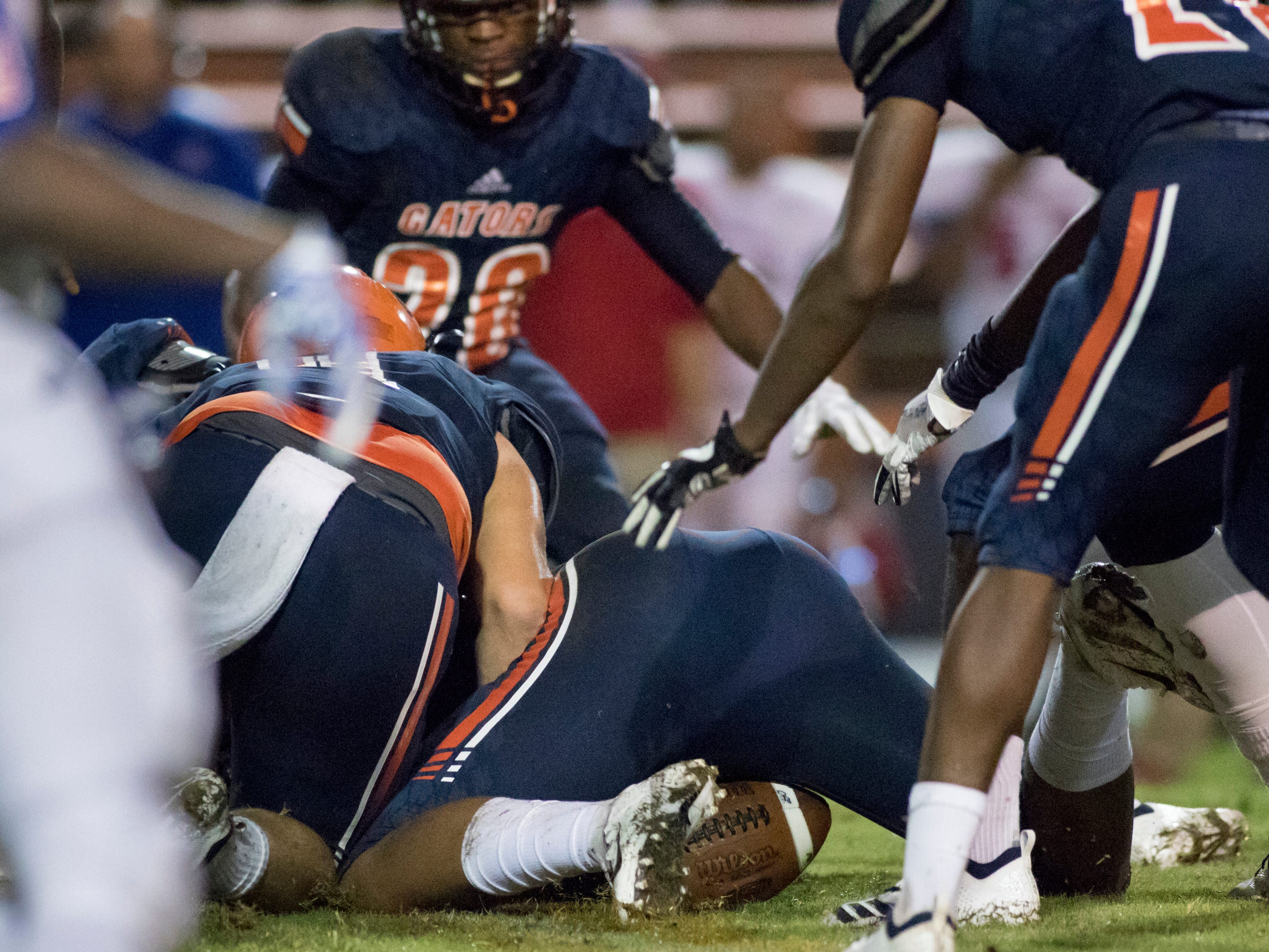 The Gators fall on an Eagles fumble during the Pine Forest vs Escambia football game at Escambia High School in Pensacola on Friday, September 28, 2018.