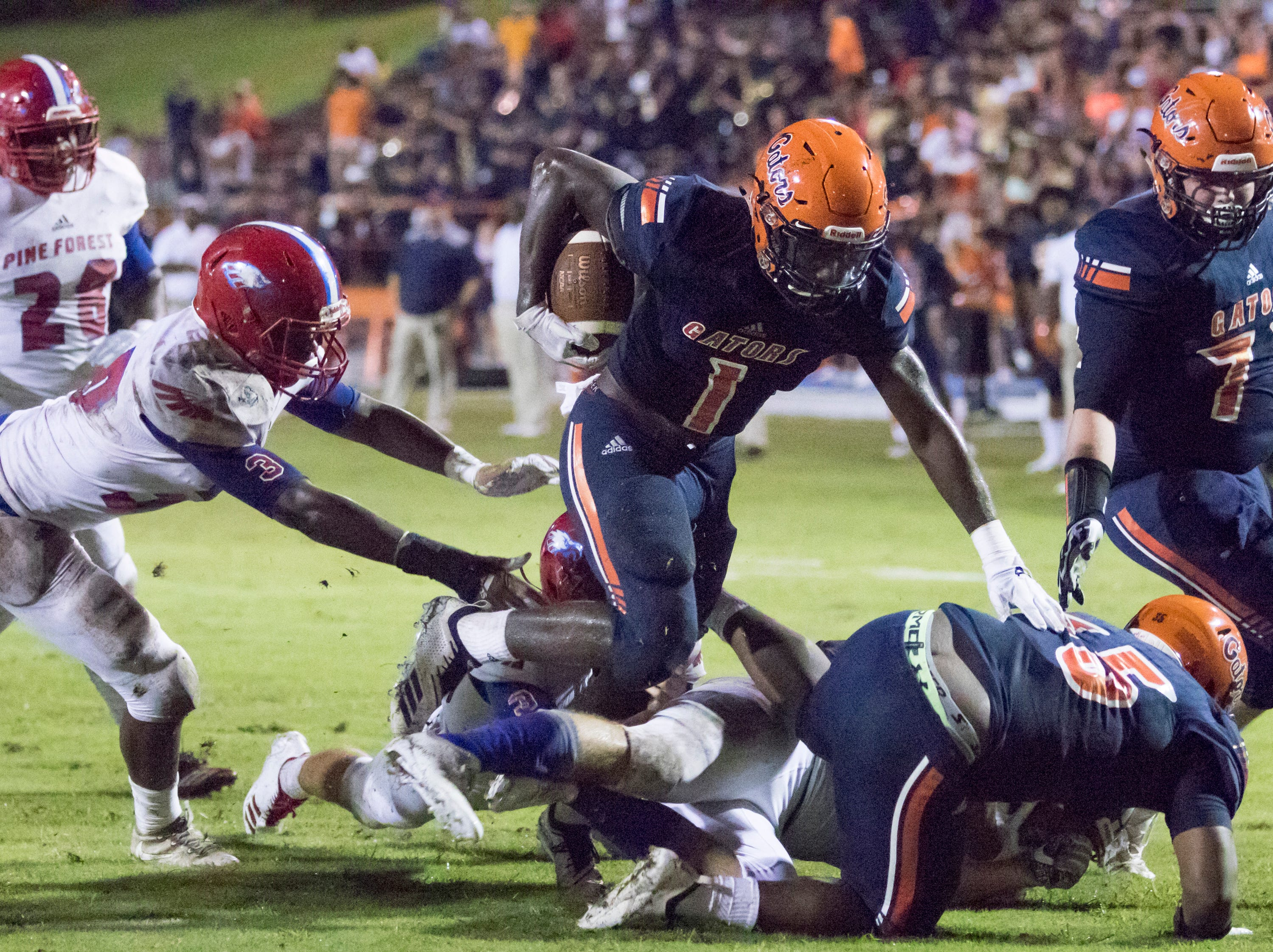 Frank Peasent (1) runs for a touchdown and a 14-7 lead during the Pine Forest vs Escambia football game at Escambia High School in Pensacola on Friday, September 28, 2018.