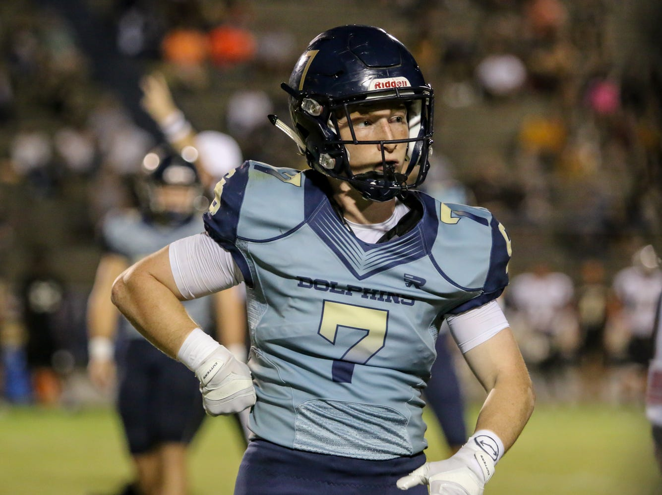 Gulf Breeze's Spencer Segal (7) waits for the next play to be called in from the sidelines against Milton in the District 2-6A game at Gulf Breeze High School on Friday.