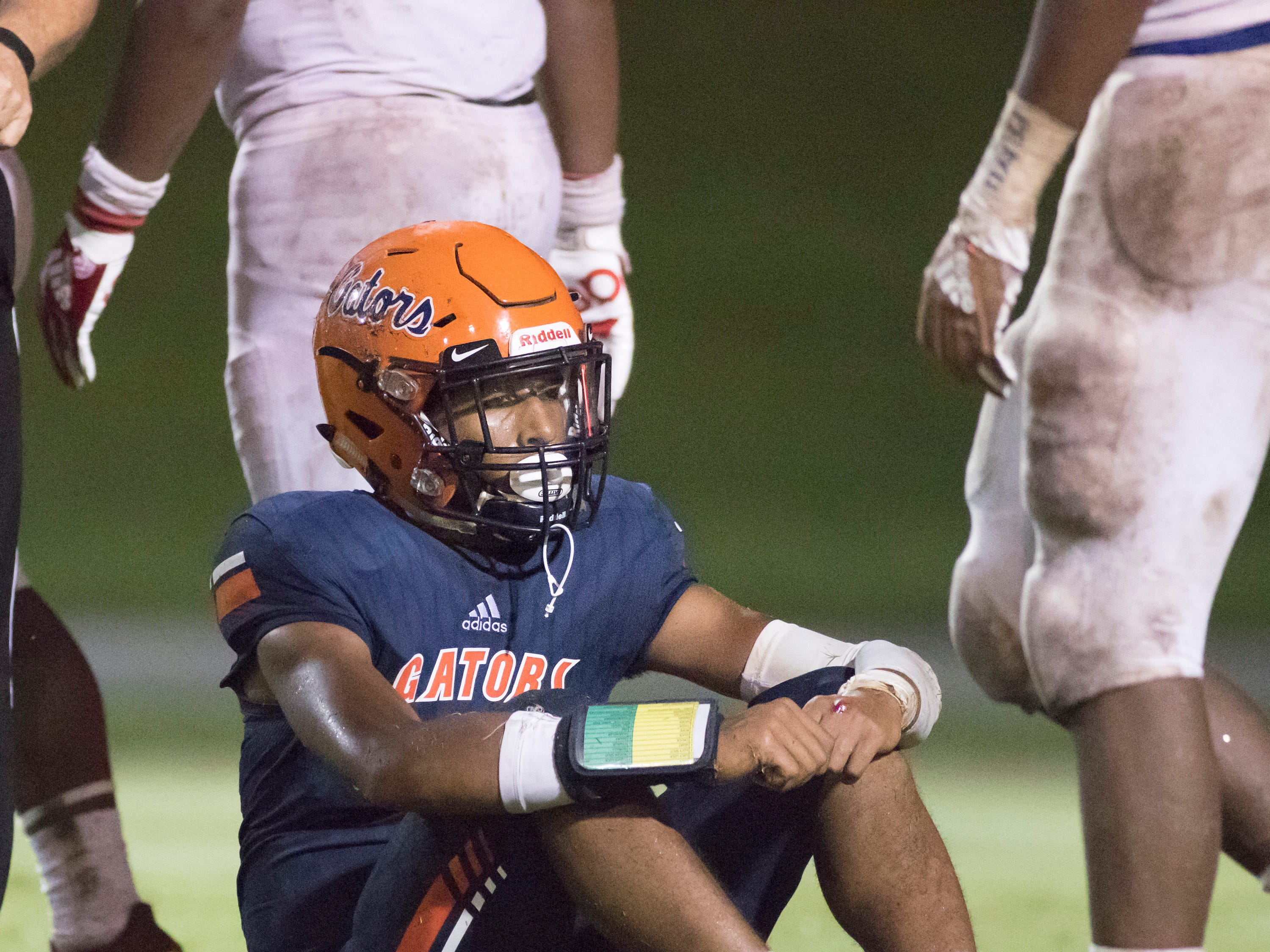 A frustrated Av Smith (5) sits after getting sacked during the Pine Forest vs Escambia football game at Escambia High School in Pensacola on Friday, September 28, 2018.