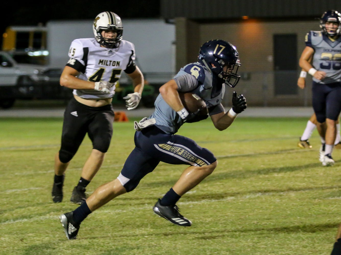Gulf Breeze's Jayden Skipper (17) races up the field against Milton in the District 2-6A game at Gulf Breeze High School on Friday.