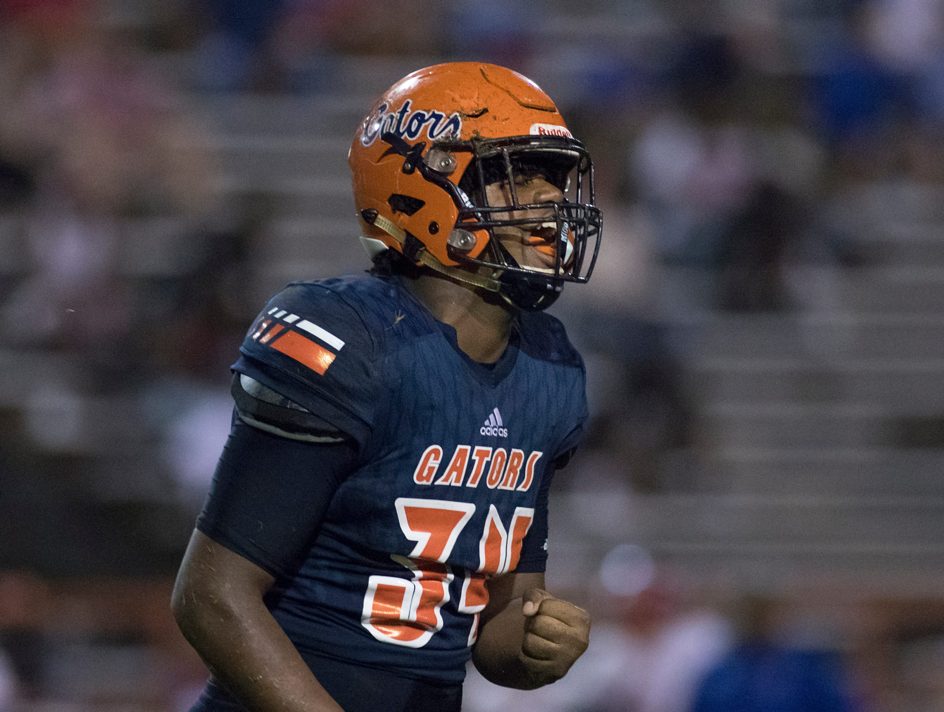 Xavier Johnson (34) celebrates after the Gators recover an Eagles fumble during the Pine Forest vs Escambia football game at Escambia High School in Pensacola on Friday, September 28, 2018.