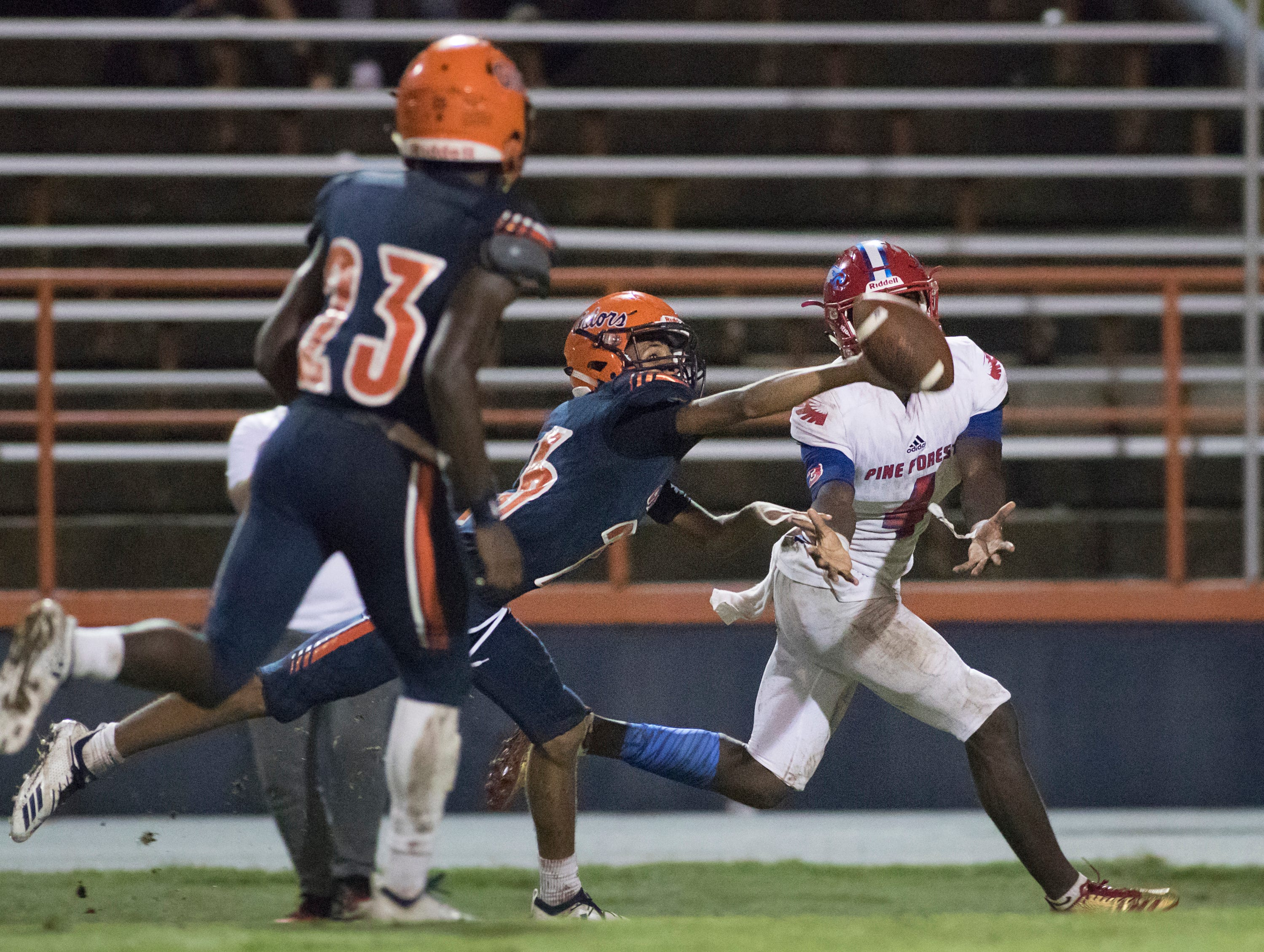 Charlie Brown III (26) breaks up a pass to Vontarious Hill (4) during the Pine Forest vs Escambia football game at Escambia High School in Pensacola on Friday, September 28, 2018.