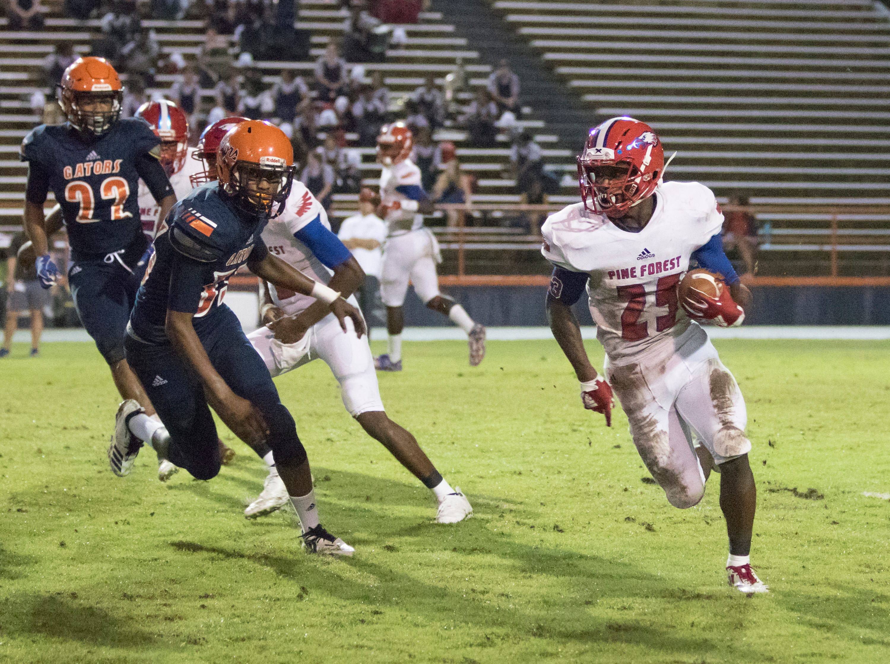 Anwar Lewis (25) carries the ball during the Pine Forest vs Escambia football game at Escambia High School in Pensacola on Friday, September 28, 2018.