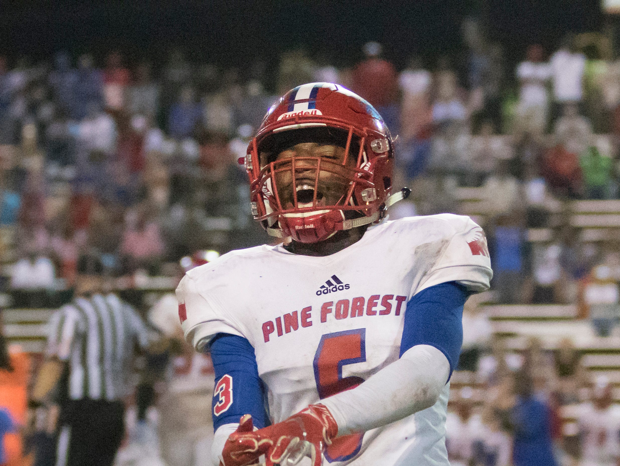 Vonquarius Brown (6) taunts the sideline  with a Gator chomp after the Eagles hold on 4th down and get the ball during the Pine Forest vs Escambia football game at Escambia High School in Pensacola on Friday, September 28, 2018.