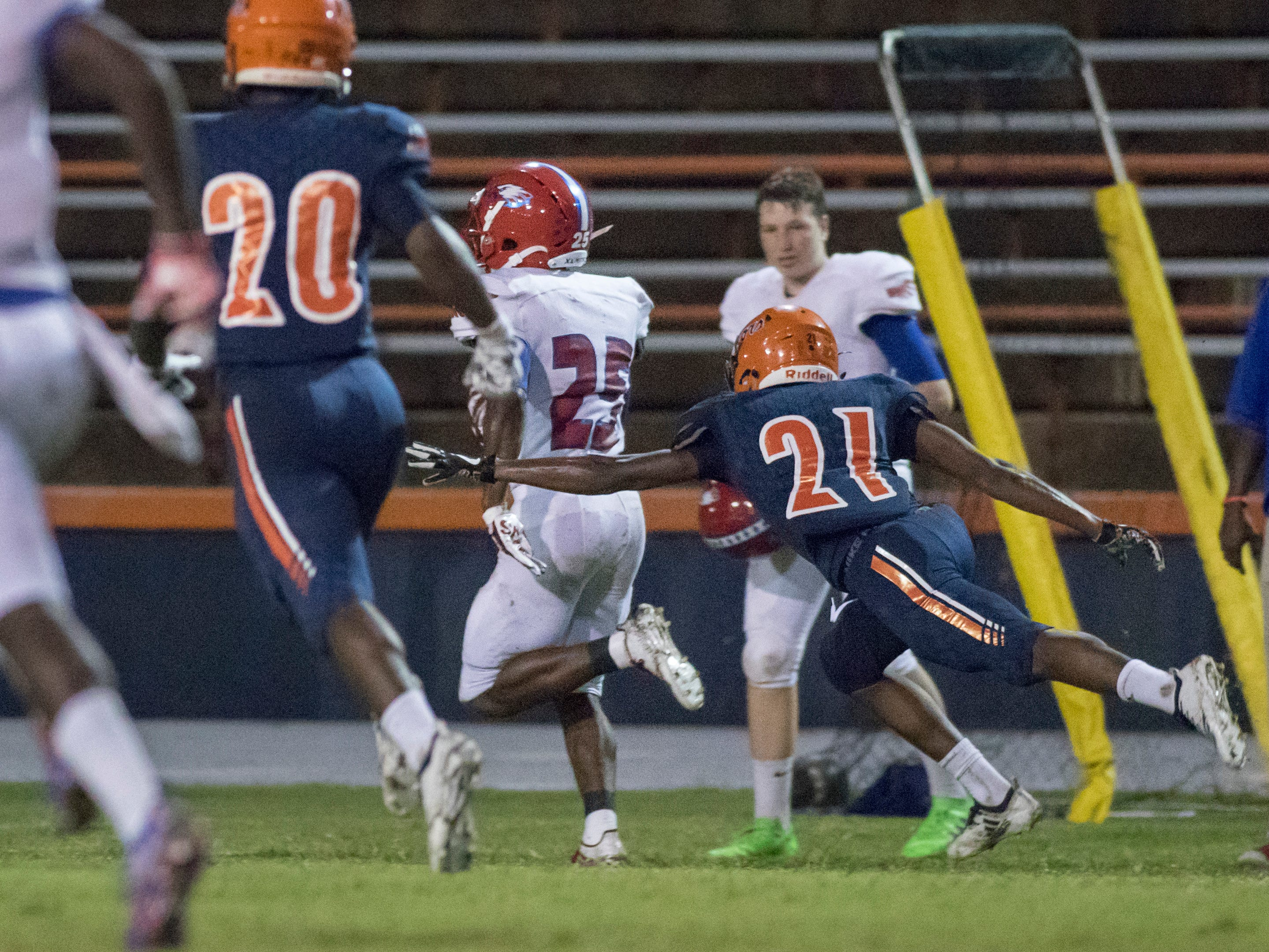 Anwar Lewis (25) races down the sideline on his way to a touchdown and a 7-7 tie during the Pine Forest vs Escambia football game at Escambia High School in Pensacola on Friday, September 28, 2018.