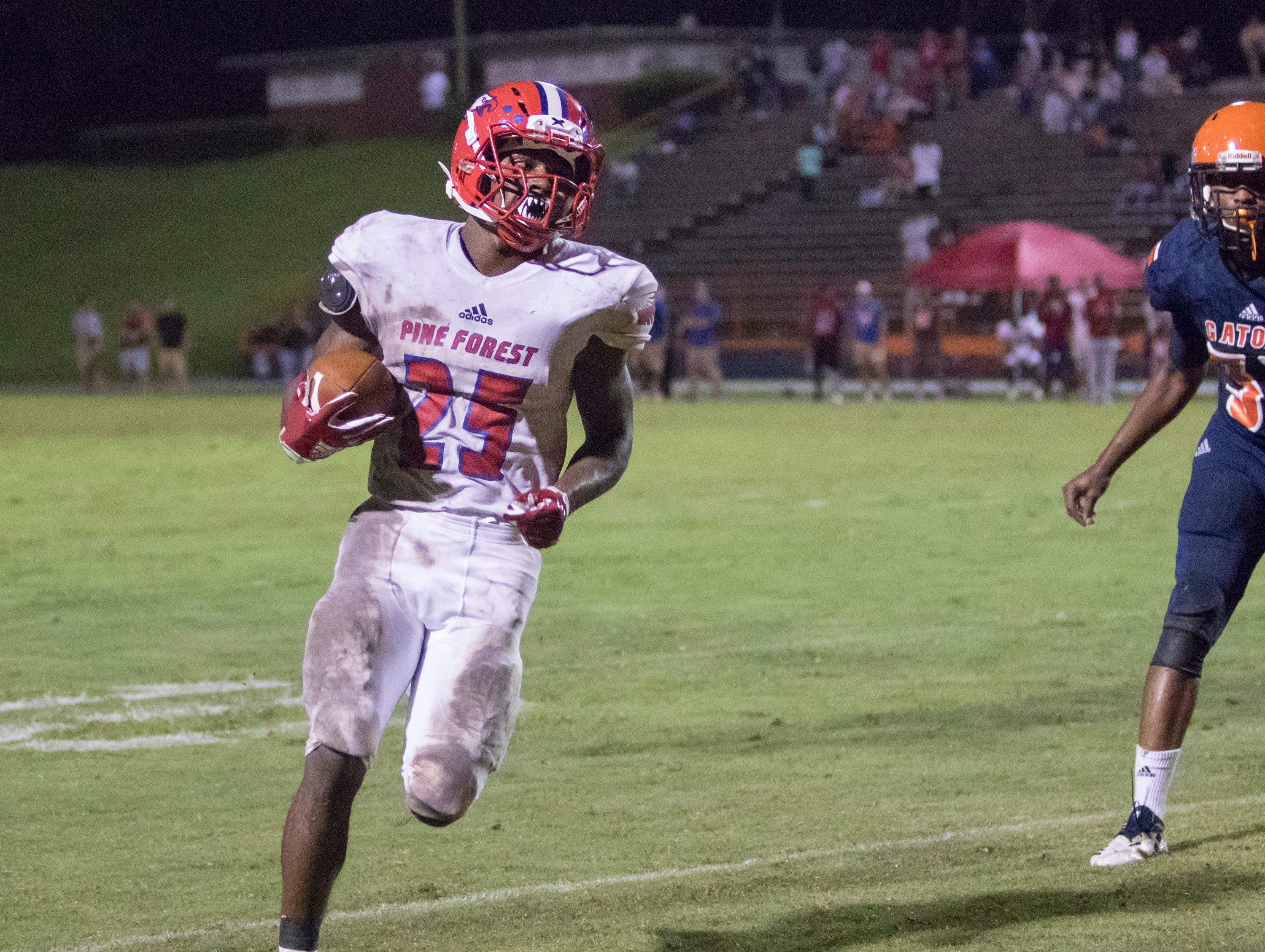 Anwar Lewis (25) runs in untouched for a touchdown and a 14-14 tie during the Pine Forest vs Escambia football game at Escambia High School in Pensacola on Friday, September 28, 2018.