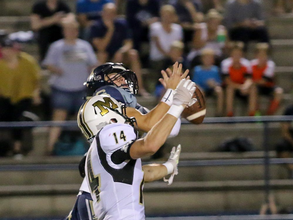 Neither Gulf Breeze's Reese Parker (24) nor Milton's Dakota Busbee (14) can catch a pass intended for Parker in the District 2-6A game at Gulf Breeze High School on Friday.