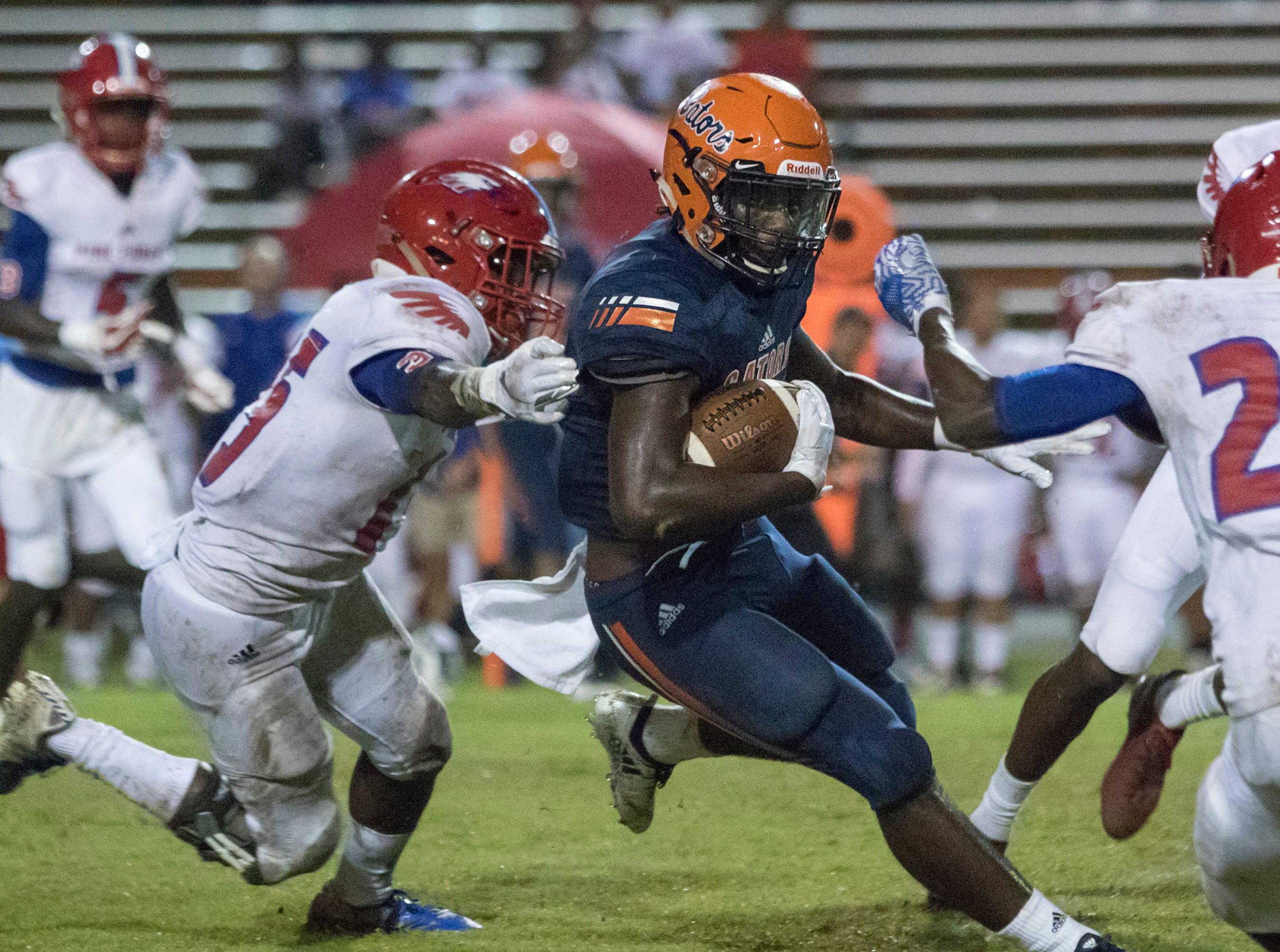 Frank Peasent (1) slips past several Eagles defenders on a big run before getting stopped just short of the goal line during the Pine Forest vs Escambia football game at Escambia High School in Pensacola on Friday, September 28, 2018.