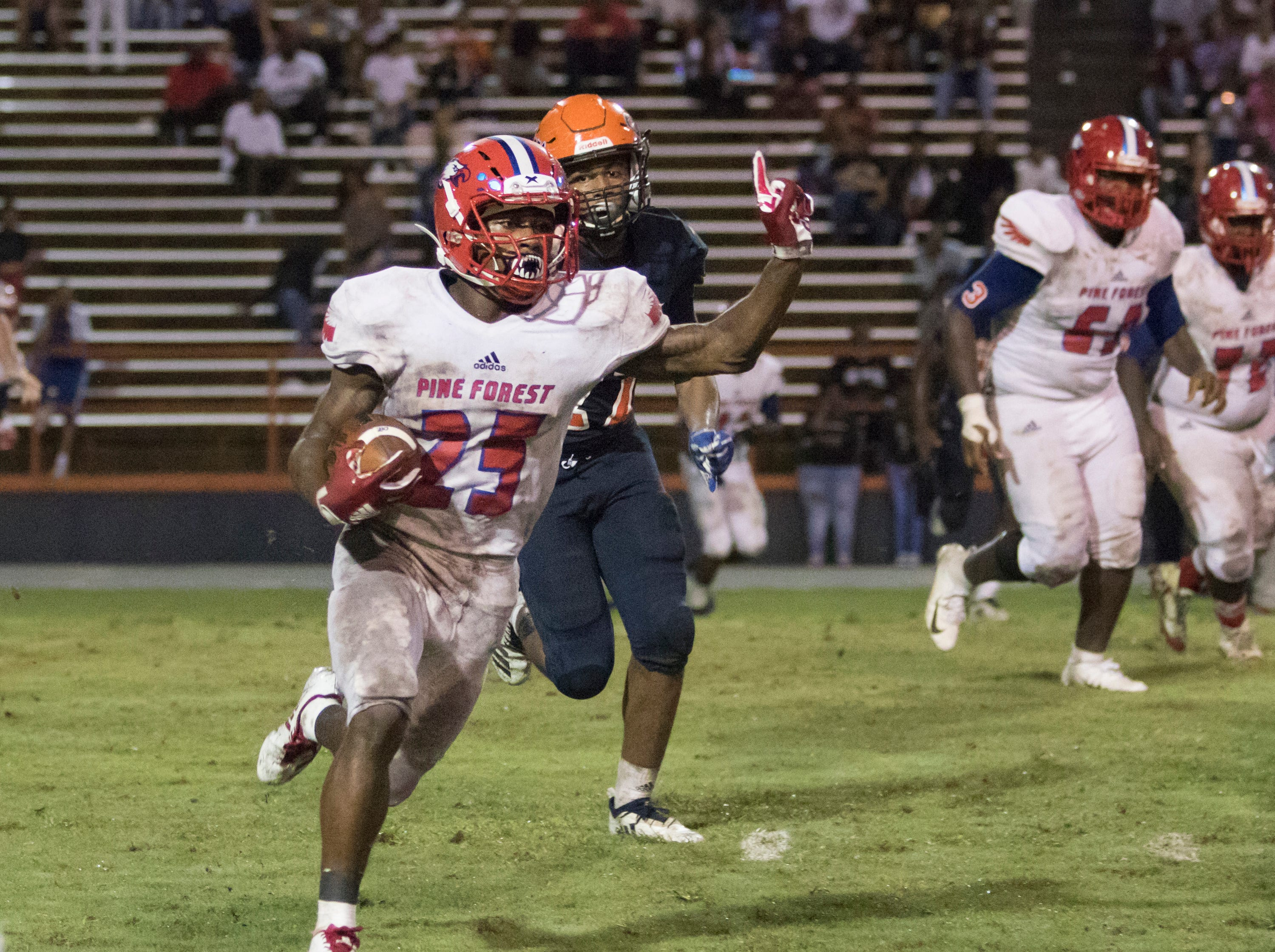 Anwar Lewis (25) directs his blockers as he runs the ball during the Pine Forest vs Escambia football game at Escambia High School in Pensacola on Friday, September 28, 2018.