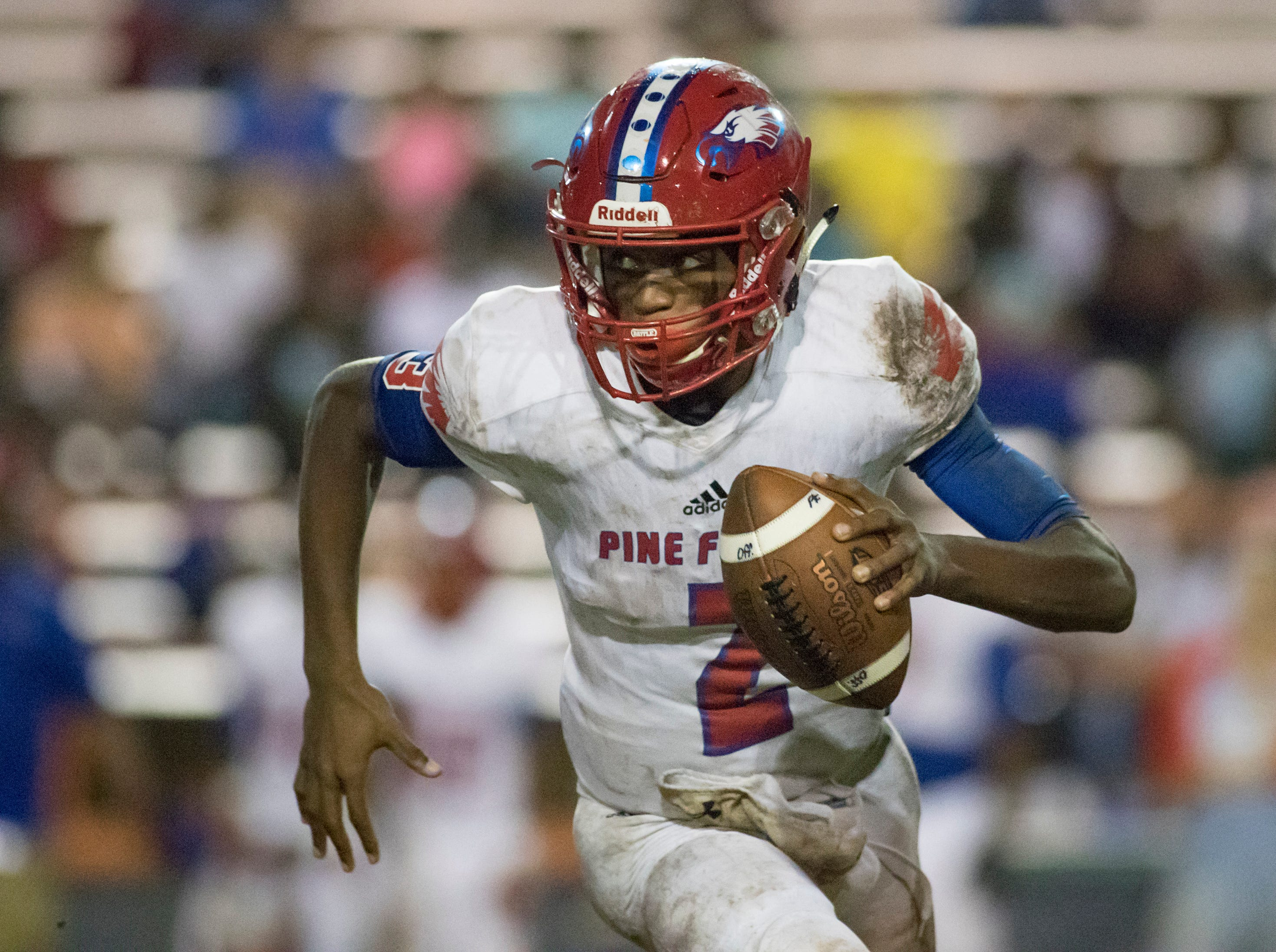 Quarterback Ladarius Clardy (2) keeps the ball during the Pine Forest vs Escambia football game at Escambia High School in Pensacola on Friday, September 28, 2018.