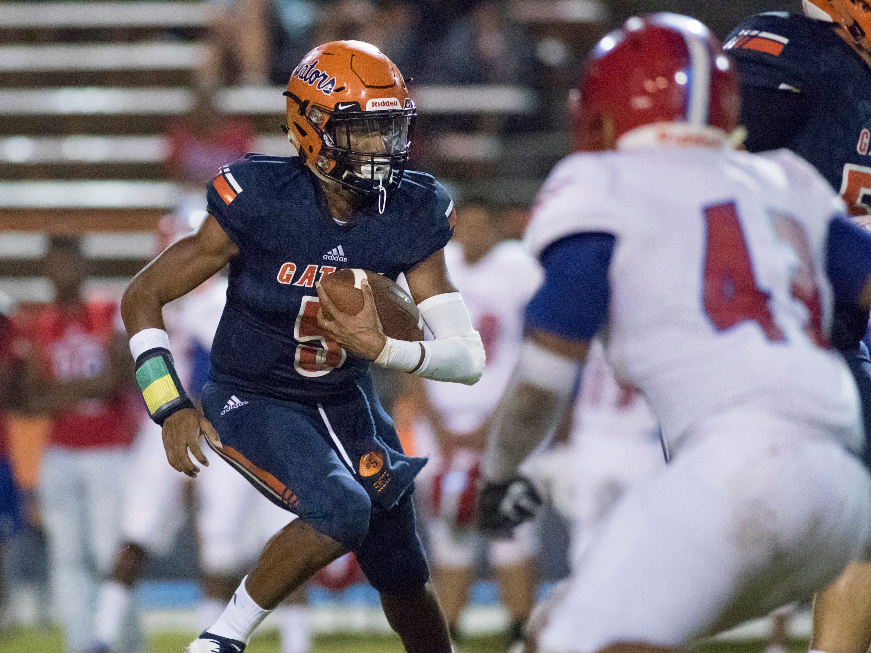 Quarterback Av Smith (5) looks for running room as he keeps the ball during the Pine Forest vs Escambia football game at Escambia High School in Pensacola on Friday, September 28, 2018.