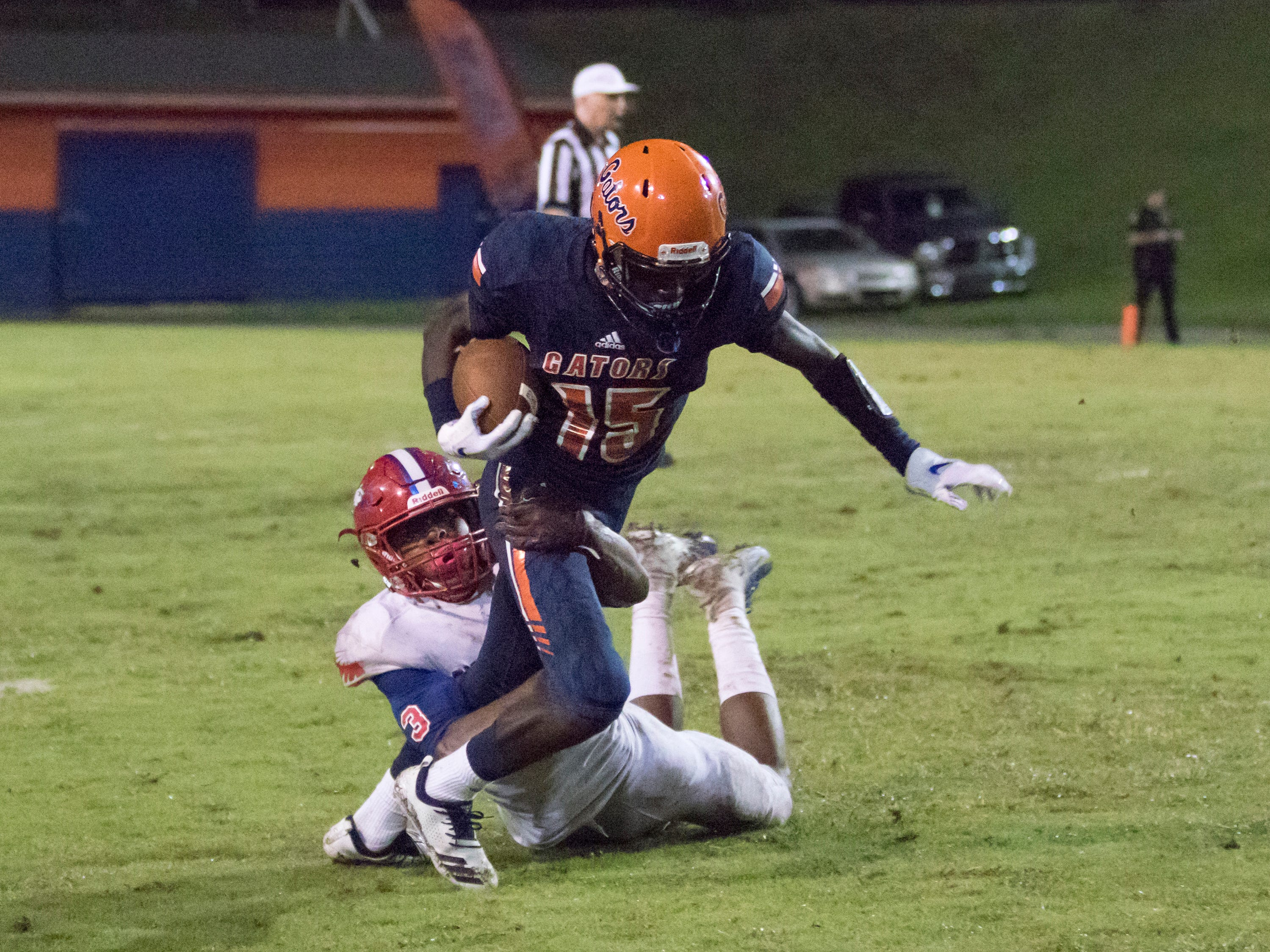 Martin Emerson (1) takes down Zakari Loveless (15) during the Pine Forest vs Escambia football game at Escambia High School in Pensacola on Friday, September 28, 2018.
