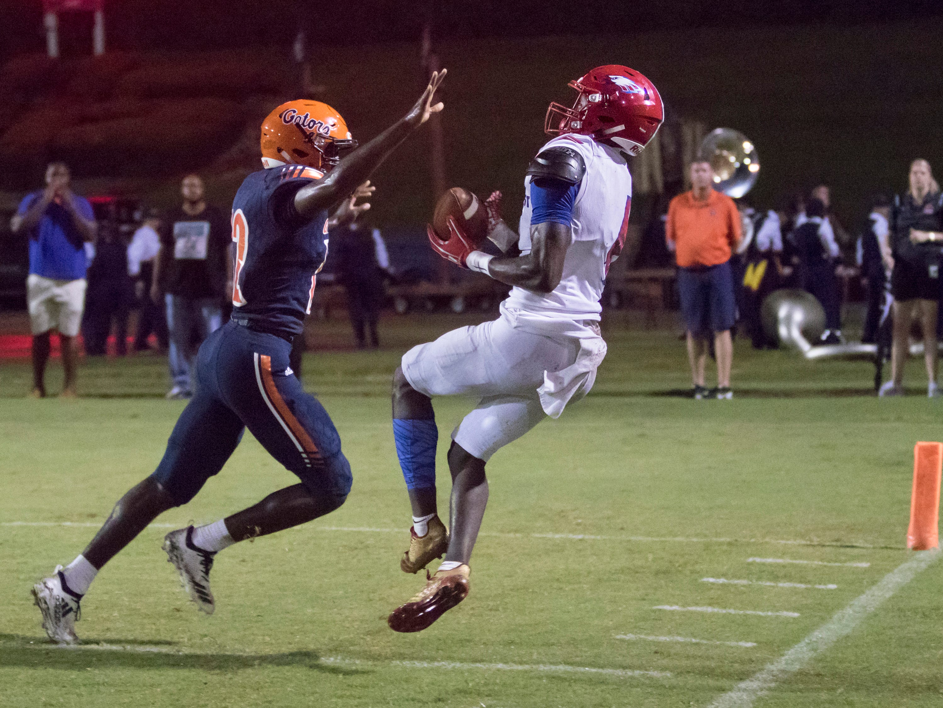 Vontarious Hill (4) hauls in a pass along the sideline during the Pine Forest vs Escambia football game at Escambia High School in Pensacola on Friday, September 28, 2018.
