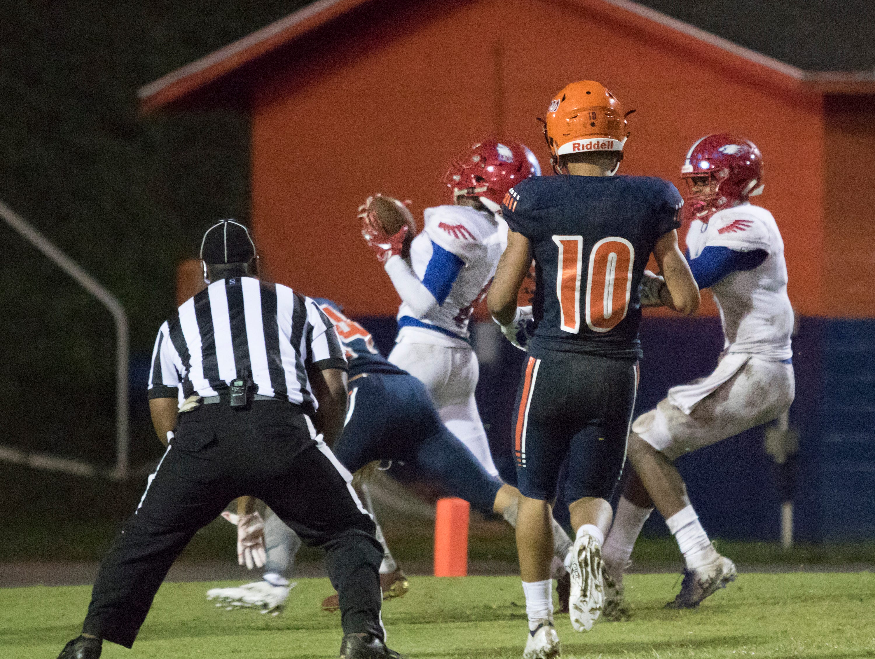 JoJo Blackmon (10) watches as Vonquarius Brown (6) intercepts a Gators pass in the endzone during the Pine Forest vs Escambia football game at Escambia High School in Pensacola on Friday, September 28, 2018.