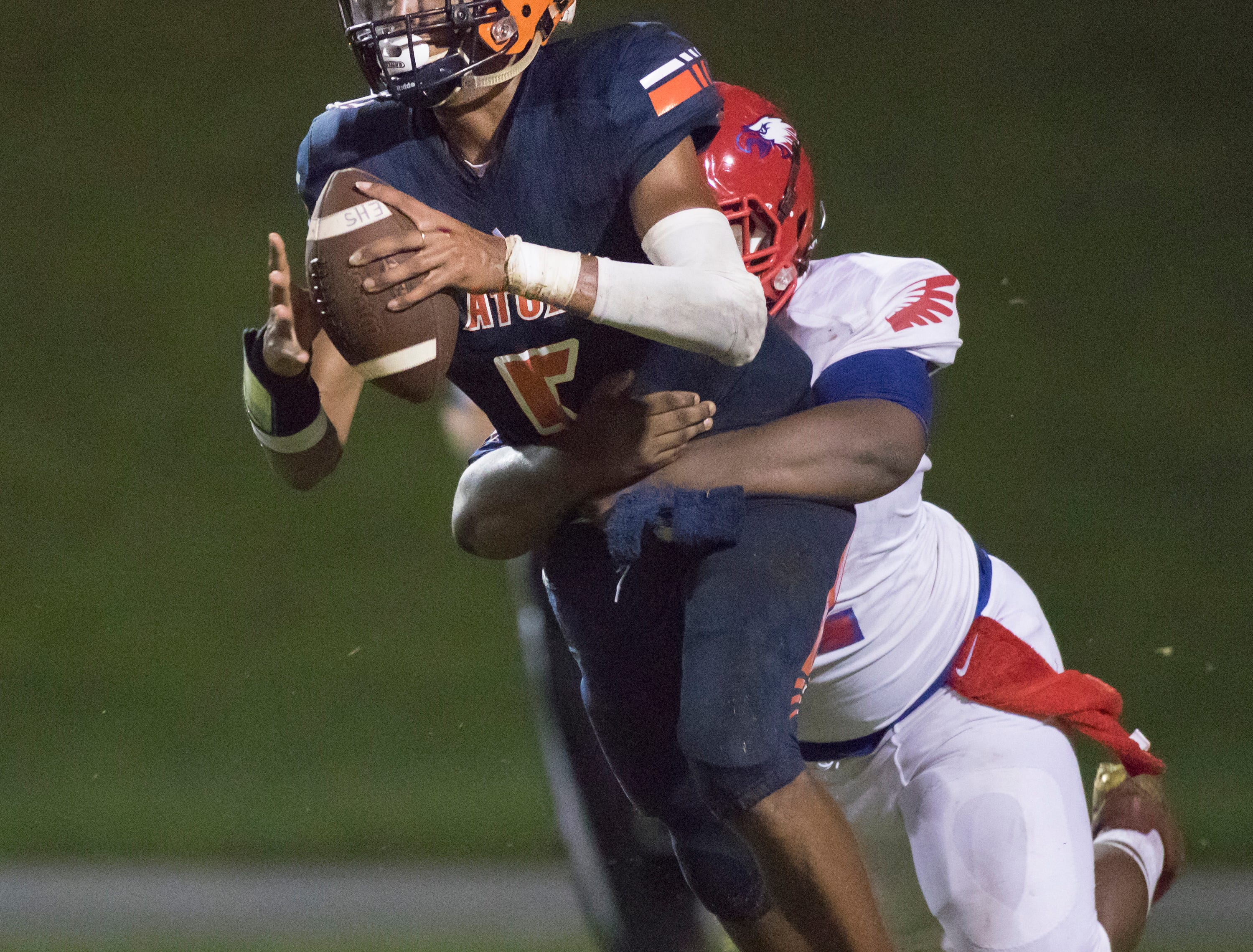 Quarterback Av Smith (5) is sacked during the Pine Forest vs Escambia football game at Escambia High School in Pensacola on Friday, September 28, 2018.