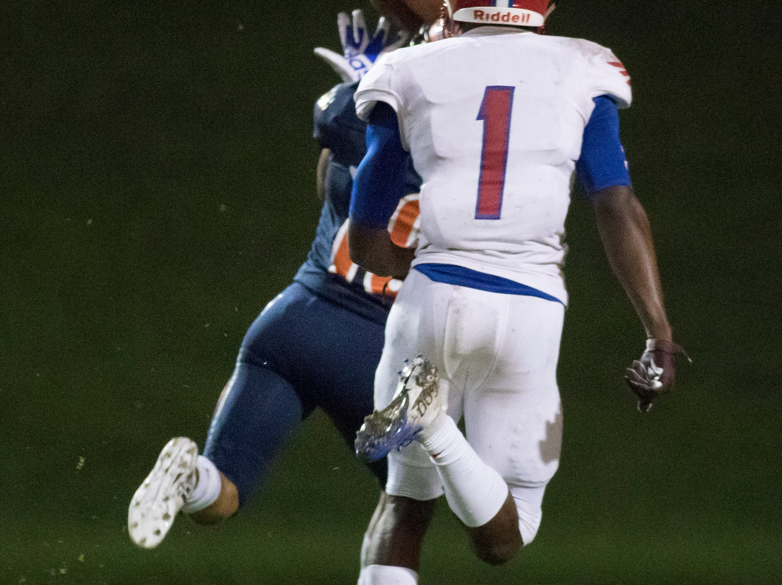 Martin Emerson (1) watches as JoJo Blackmon (10) catches a long pass for a touchdown leading to a 7-0 score during the Pine Forest vs Escambia football game at Escambia High School in Pensacola on Friday, September 28, 2018.
