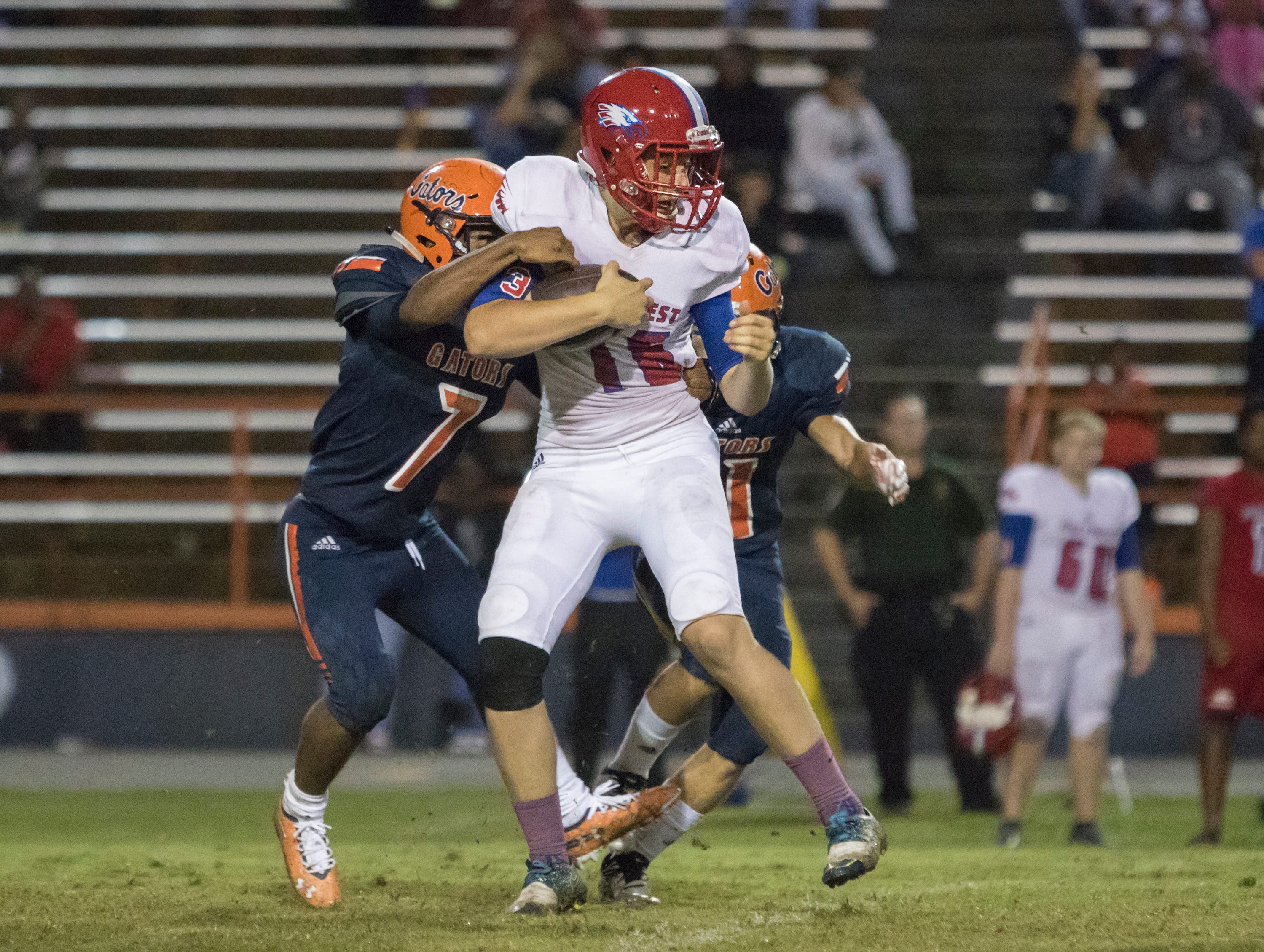 Punter Bryce Alderman (16) is tackled after fumbling a snap during the Pine Forest vs Escambia football game at Escambia High School in Pensacola on Friday, September 28, 2018.