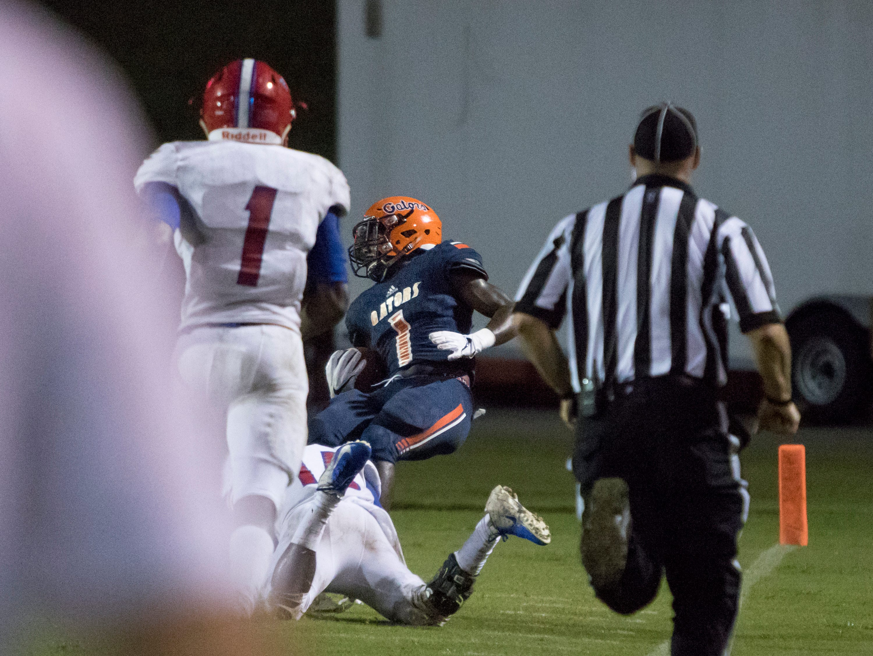 Frank Peasent (1) is stopped just short of the goal line after a big run during the Pine Forest vs Escambia football game at Escambia High School in Pensacola on Friday, September 28, 2018.