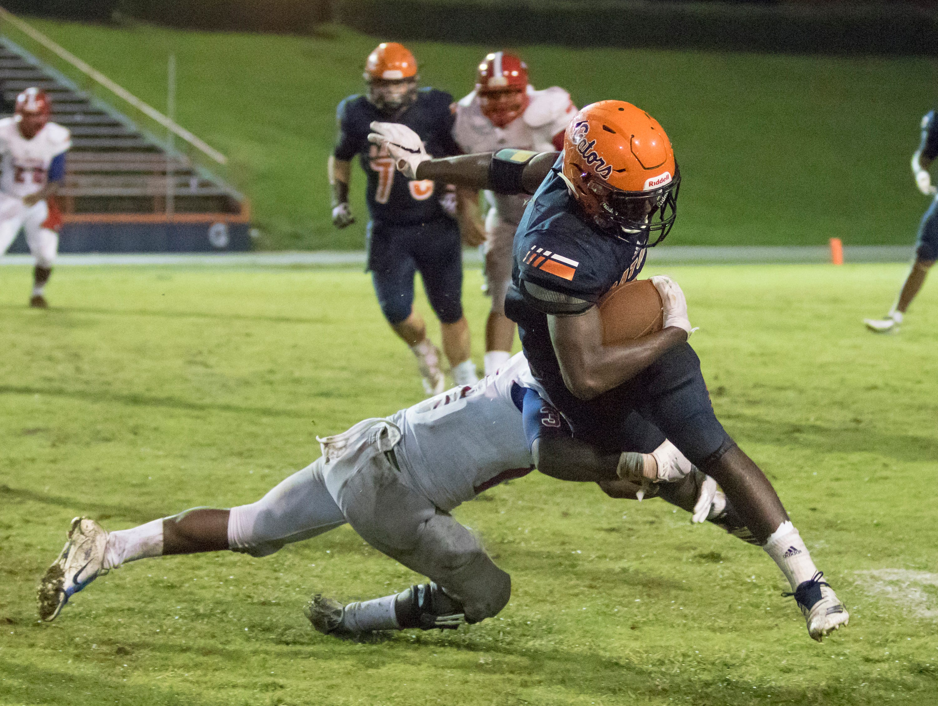 Mitrez Rawls (15) wraps up Frank Peasent (1) during the Pine Forest vs Escambia football game at Escambia High School in Pensacola on Friday, September 28, 2018.