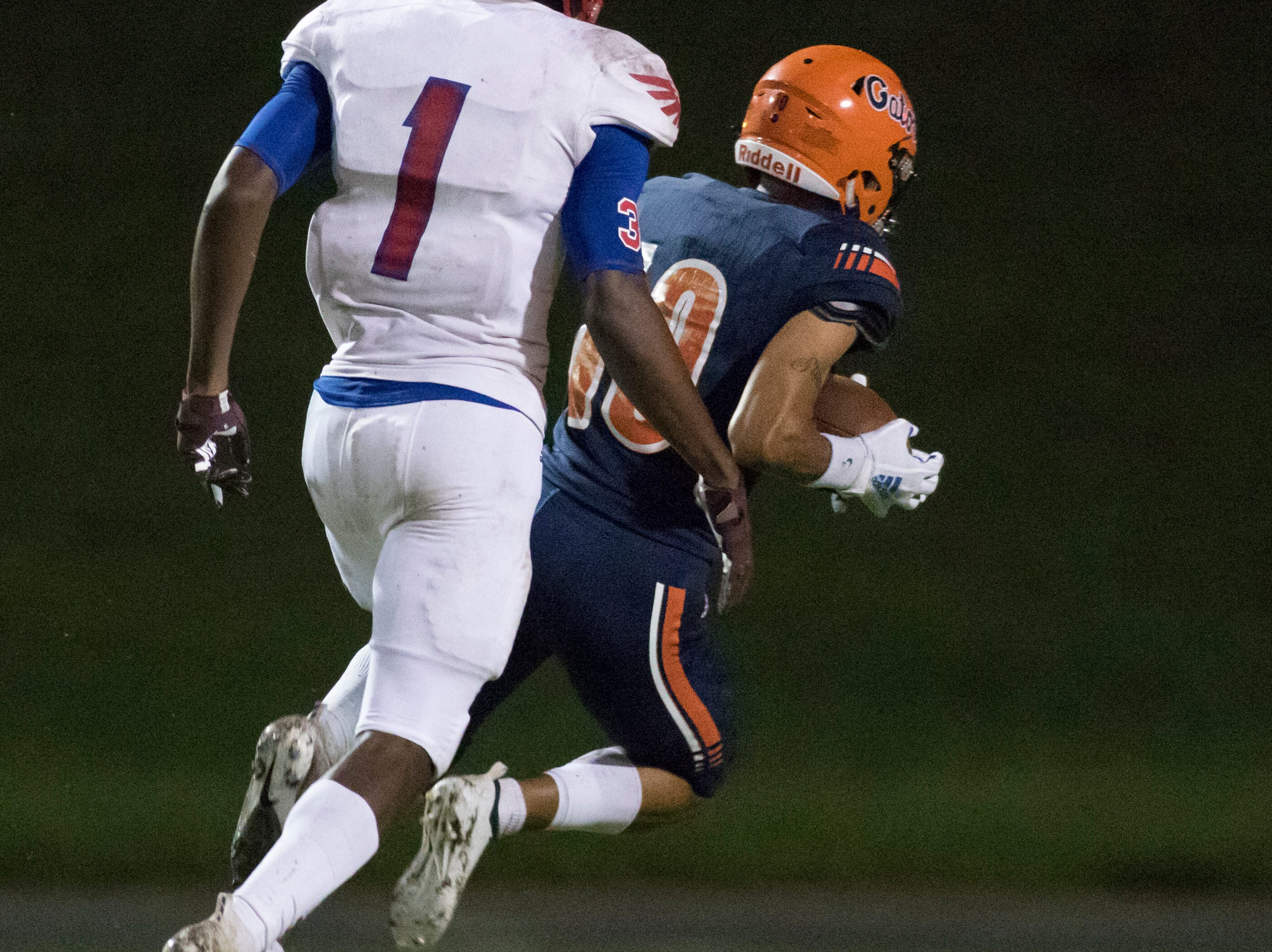 Martin Emerson (1) watches as JoJo Blackmon (10) takes a long pass in for a touchdown leading to a 7-0 score during the Pine Forest vs Escambia football game at Escambia High School in Pensacola on Friday, September 28, 2018.