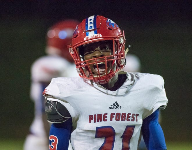 Devon Witherspoon (21) celebrates after making a stop during the Pine Forest vs Escambia football game at Escambia High School in Pensacola on Friday, September 28, 2018.