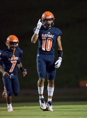 JoJo Blackmon (10) celebrates after scoring the first touchdown during the Pine Forest vs Escambia football game at Escambia High School in Pensacola on Friday, September 28, 2018.