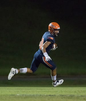 JoJo Blackmon (10) takes it in for a touchdown leading to a 7-0 score during the Pine Forest vs Escambia football game at Escambia High School in Pensacola on Friday, September 28, 2018.