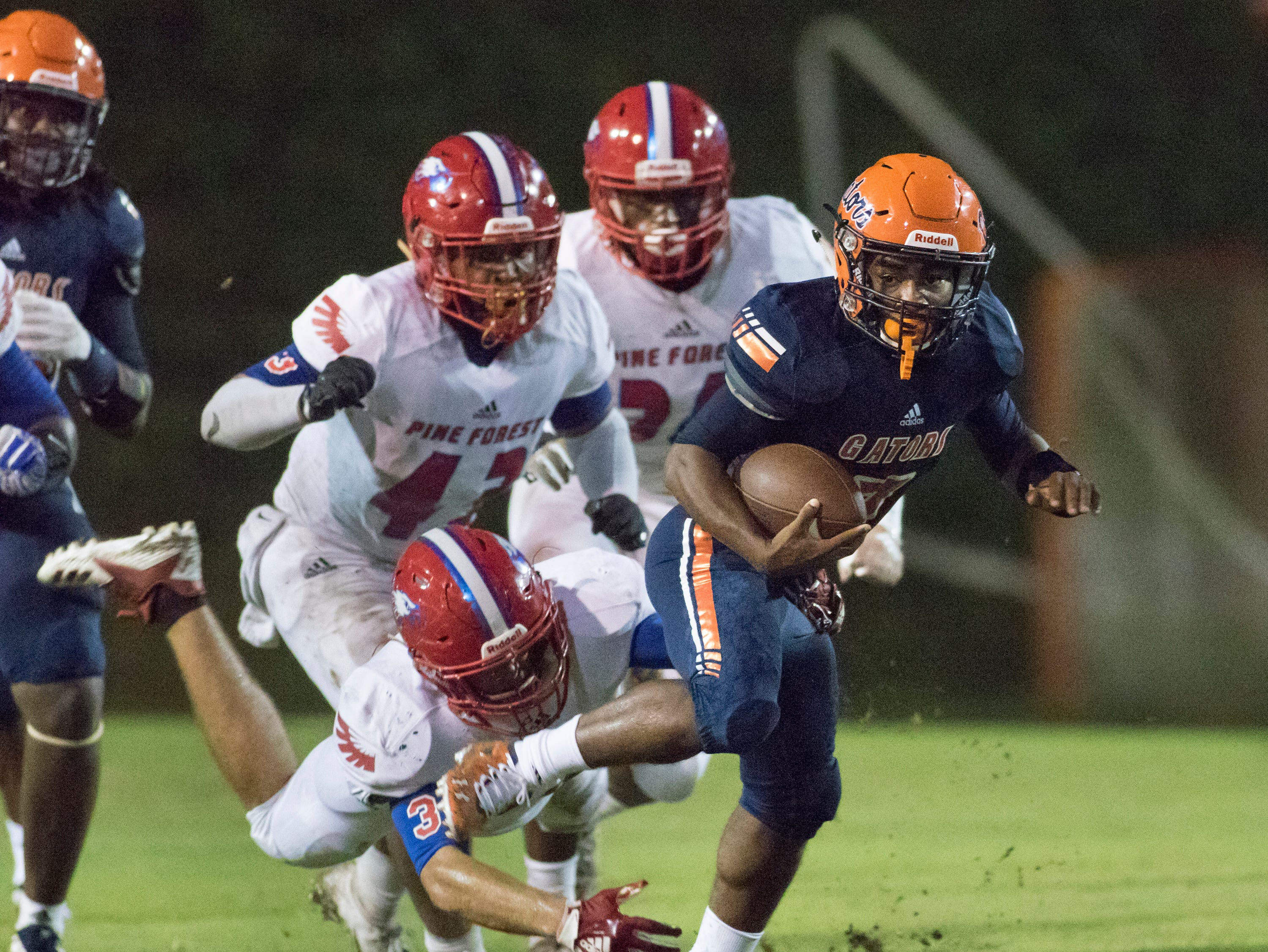 Kyaire Hall (7) slips a tackle for a big pick up during the Pine Forest vs Escambia football game at Escambia High School in Pensacola on Friday, September 28, 2018.