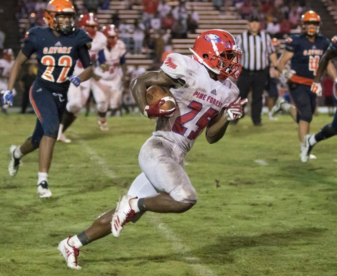 Anwar Lewis (25) finds open field during the Pine Forest vs Escambia football game at Escambia High School in Pensacola on Friday, September 28, 2018.