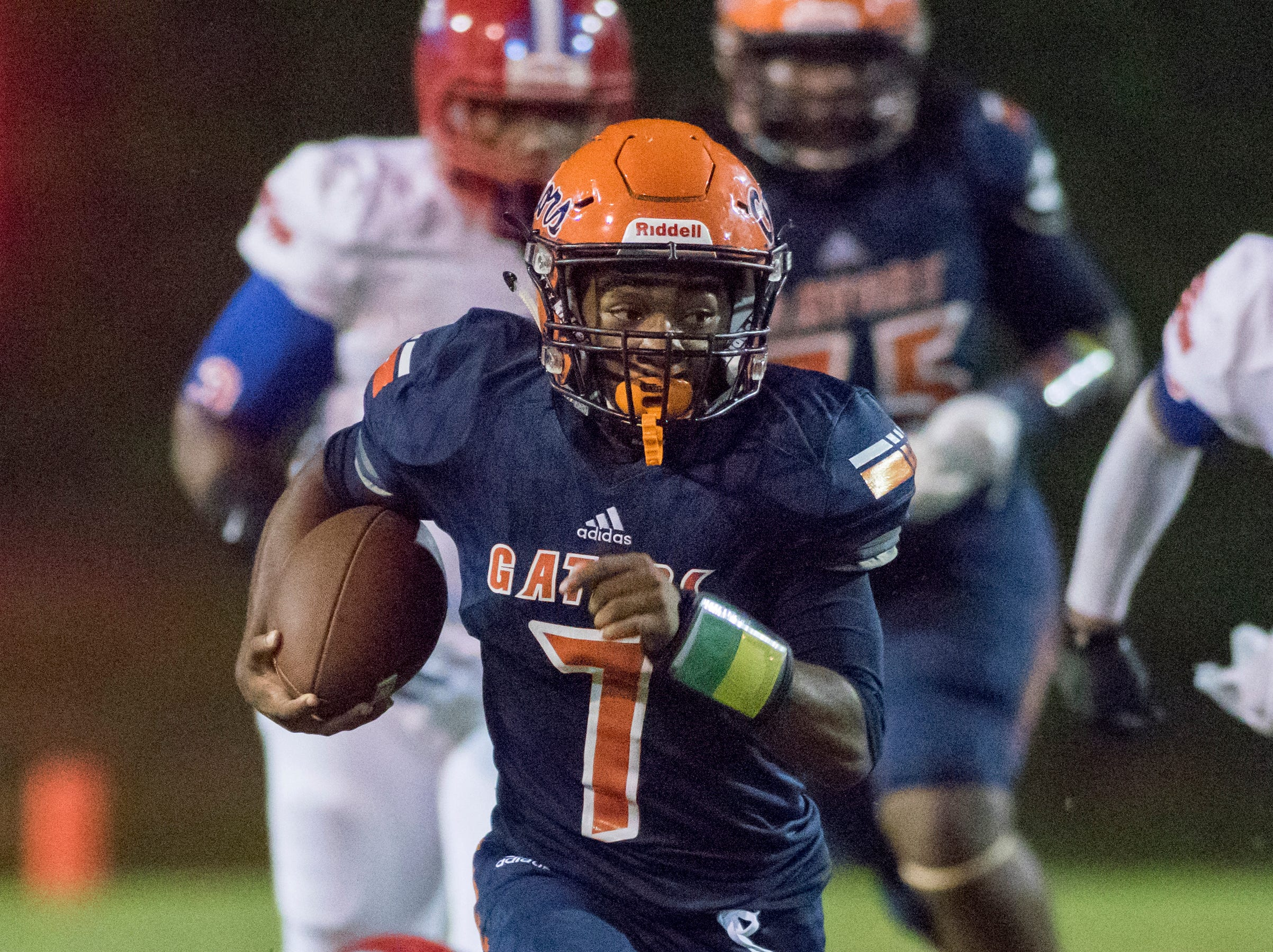 Kyaire Hall (7) gets a big pick up after slipping a tackle during the Pine Forest vs Escambia football game at Escambia High School in Pensacola on Friday, September 28, 2018.